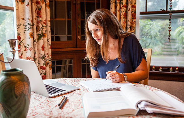 Kathleen Garney, an Ecampus MBA student, does course work from her home