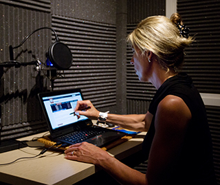 Amy Bourne works on one of her courses in the Ecampus recording studio