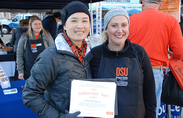 Ecampus student Carol Abrogoua, right, poses with Moore Family Center director Emily Ho at the GridIron Chef Contest.