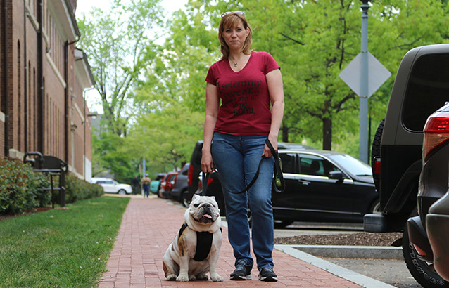 Ecampus business administration student Christine Mosser and her bulldog, Chesty.
