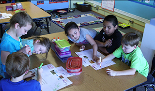 First graders in a dual language program work on a project.