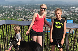 Rachel Hensley, OSU Ecampus anthropology graduate with her children and dog